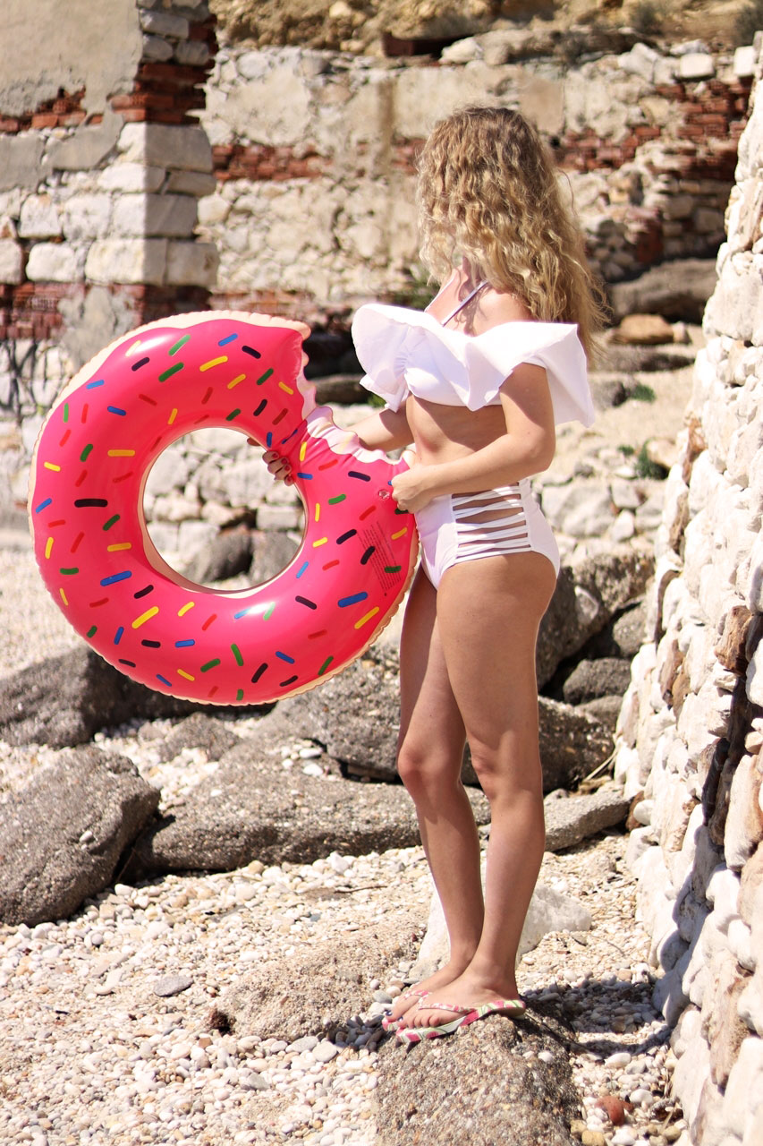 pink.floats.donuts.beach